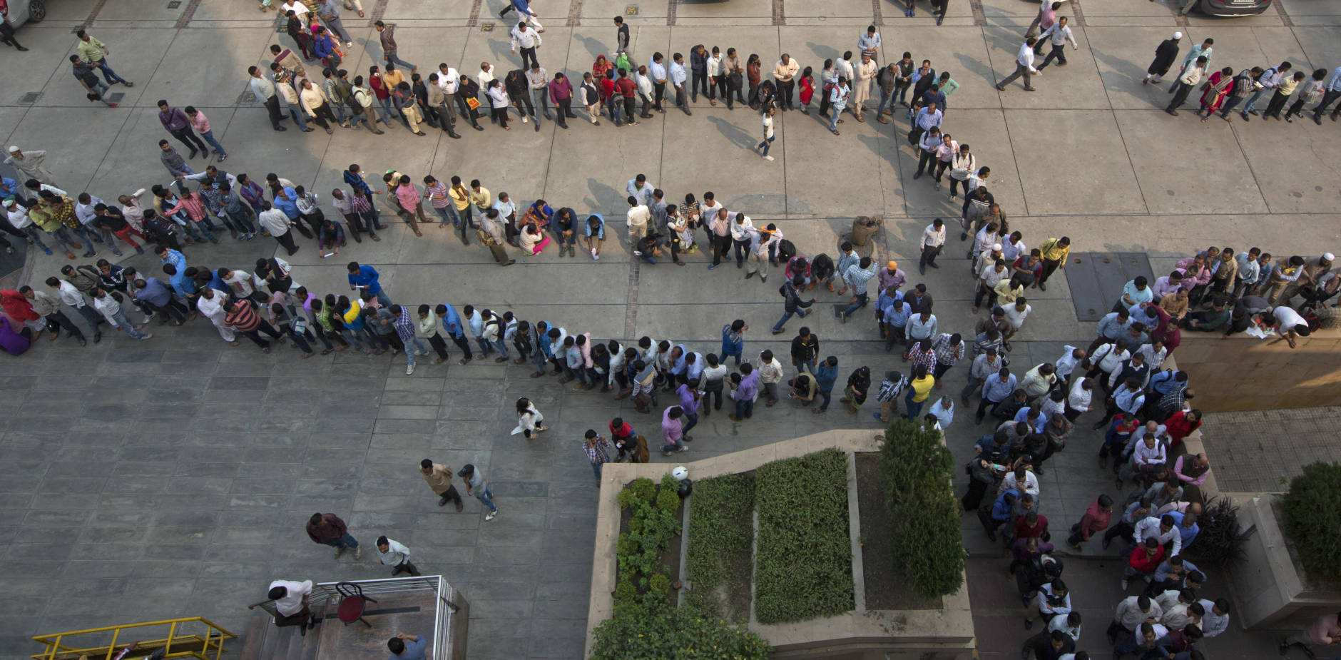 Indians stand in queues at a bank to exchange or deposit discontinued currency notes in New Delhi, India, Tuesday, Nov. 15, 2016. Chaotic scenes played out across India with long lines growing even longer and scuffles breaking out, as millions of anxious people tried to change old currency notes that became worthless days earlier when the government demonetized high-value bills. (AP Photo/Manish Swarup)